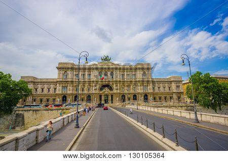 ROME, ITALY - JUNE 13, 2015: Corte di Cassazione or Supreme court in Rome, nice building at the end of Vittorio ponte. People crossing the bridge