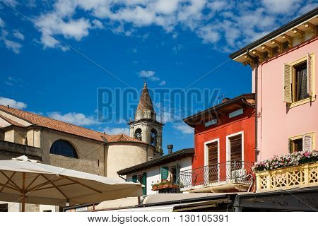 Peschiera del Garda Italy - May 03 2016: View of the tower of San Martino church from the square of Ferdinando di Savoia spring time