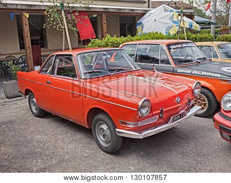 VILLA ROTTA, FORLI, ITALY - MAY 1: vintage BMW 700 Coupe Sport of the sixties with roll cage in classic car rally during the feast