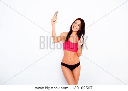 Beautiful Slim Young Woman Making Selfie Photo On Smartphone