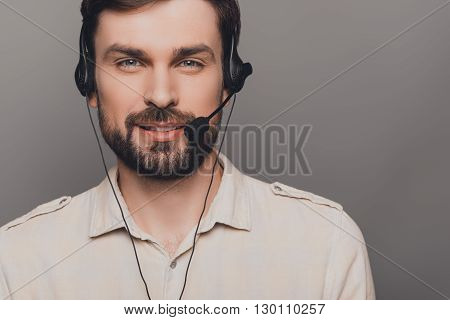 Call Center. Portrait Of Handsome Smiling Man In Head-phones
