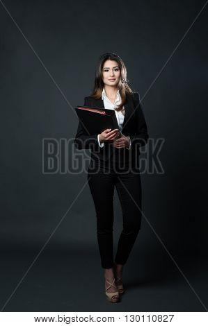 Beautiful young business woman holding a folder