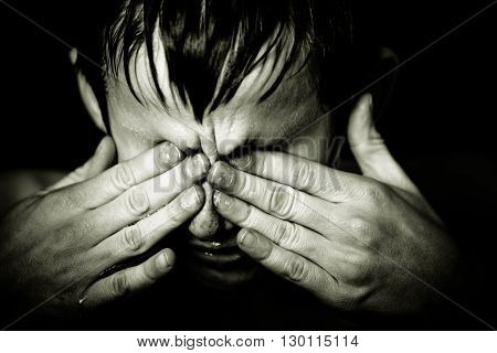 Black And White Image Of Boy Rubbing His Eyes