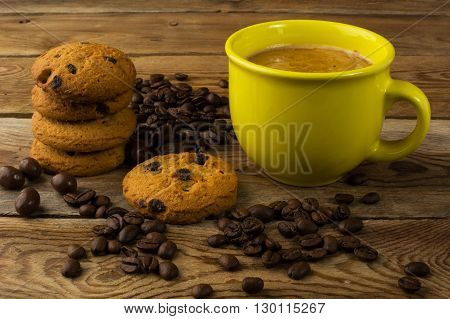 Yellow mug of strong coffee and cookies. Cup of coffee. Strong coffee. Morning coffee. Coffee break. Coffee mug. Strong coffee. Coffee cup.