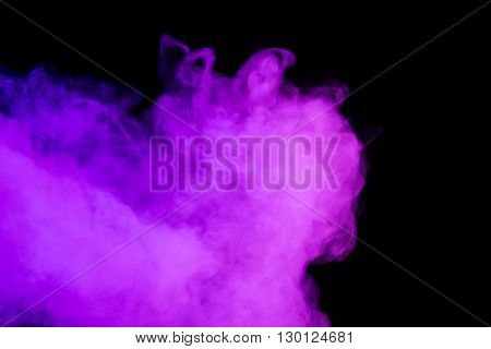 Abstract art. Purple smoke hookah on a black background. Inhalation. The steam generator. The concept of poison gas. Gas.