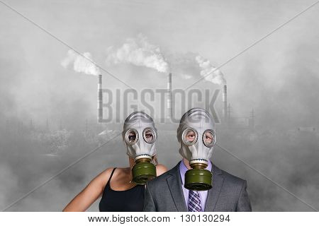 Business people wearing gas mask on the pollution air and factory background