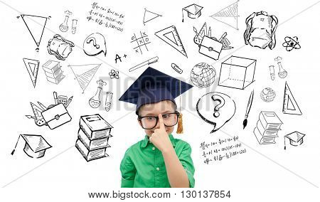 childhood, school, education, learning and people concept - happy boy in bachelor hat or mortarboard and eyeglasses with doodles