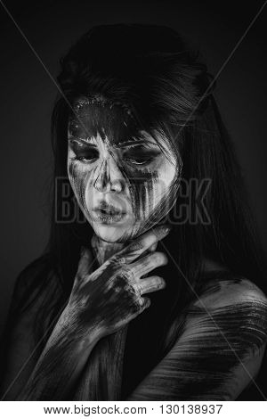 Scary portrait of the woman. Self-damage, self-destruction, suicide idea. Black-and-white Version of the Image
