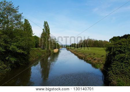 View Down A Canal With Trees On One Side