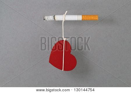 Heart as symbol of life is connected with cigarette and it is dependent on cigarette