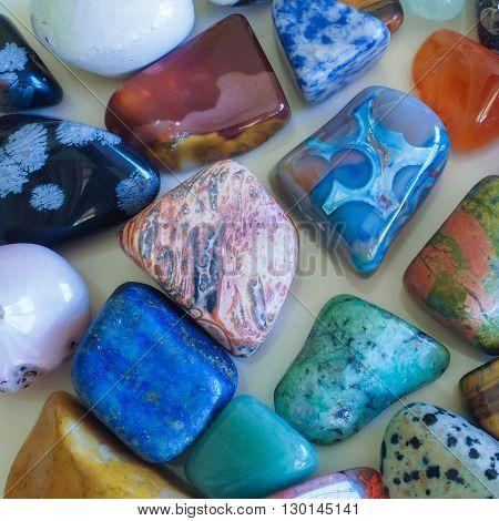 An assortment of semi-precious gem stones, closeup.