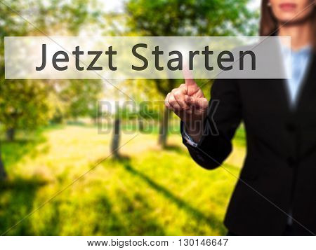 Jetzt Starten (start Now In German)  - Businesswoman Hand Pressing Button On Touch Screen Interface.