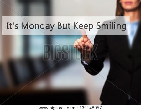 It's Monday But Keep Smiling  - Businesswoman Hand Pressing Button On Touch Screen Interface.