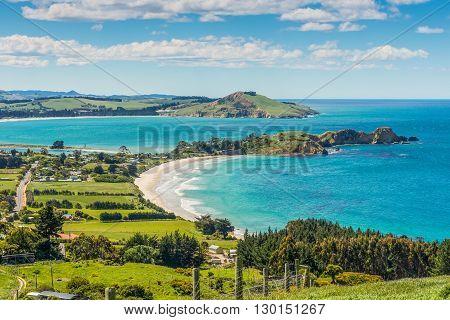 Karitane coastline Huriawa Peninsula in the center (Historic Maori Pa Site) Karitane near Dunedin Otago South Island New Zealand