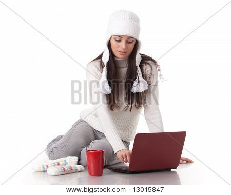 Young  Woman In Winter Clothes With Laptop.