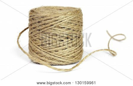 Skein of jute rope for packing, isolated on a white background.