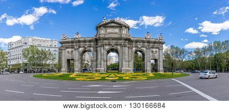 MADRID,SPAIN - APRIL 24,2016 - Panorama view at the Alcala Gate in Madrid. The Alcala Gate (Puerta de Alcala) is a Neo-classical monument in the Independent Place in Madrid.