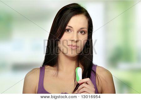 Sad woman with pregnancy test