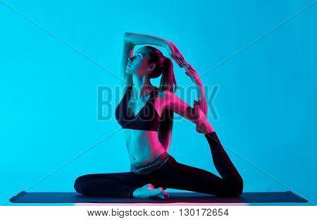 woman yoga exercices Rajakapotasana  King pigeon