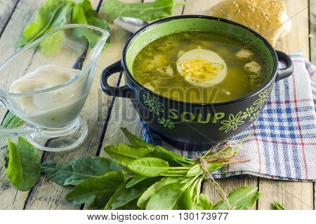 green borsch with sorrel and egg in the tureen