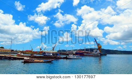 Cloudy seascape from Chatham Island. Ships and boats at the jetty in foreground, Port Blair, Andaman and Nicobar Islands, India, Asia.