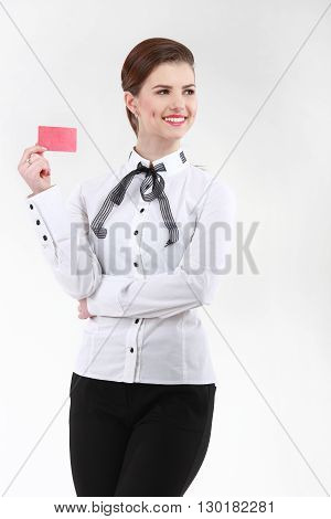 Smiling Businesswoman With A Blank Business Badge Isolated On Wh