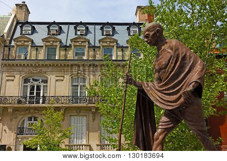 WASHINGTON DC USA - MAY 8 2016: A public monument of Mohandas Karamchand Gandhi installed in front of the Embassy of India in Washington DC on May 8 2016.