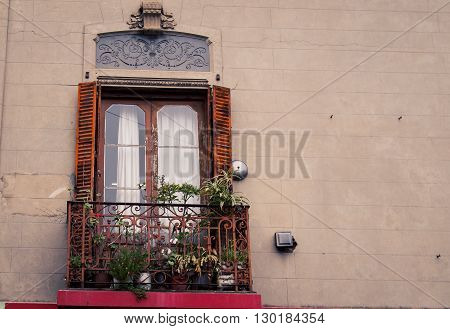 A window and balcony in  la boca argentina