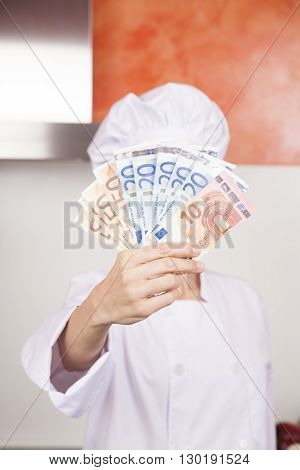 Wad Of Euro Banknotes In Chef Hand