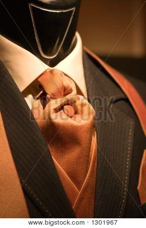 Brown Tie And Black Suit On Shop Mannequins