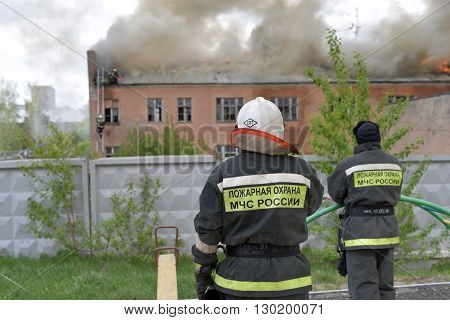 NOVOSIBIRSK RUSSIA - MAY 18 2016: Fire on the territory of a military unit in the city of Novosibirsk
