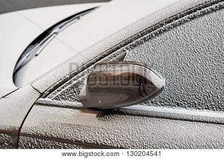 Beautiful car covered with snow - Topaz Brown Metallic color