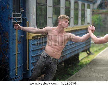 Muscular Guy Near Railway Train