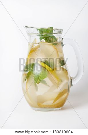 Glass jar with iced pears and mint lemonade