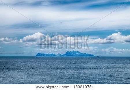 Capri island view from the sea of naples. In a cloudy day. taly