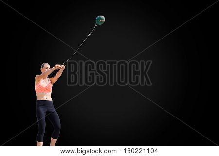 Portrait of sportswoman practising hammer throw