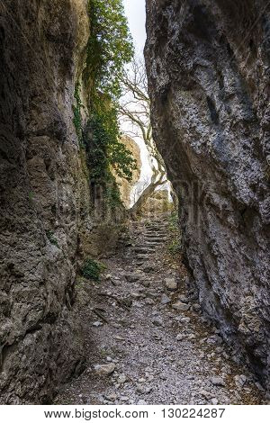 The Passage Between The Rocks  In The Canyon Crevice. Path To The Light In The End