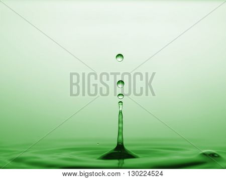 water drops and waves afloat on green background