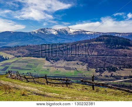 Rural Area With Snowy Mountain Tops