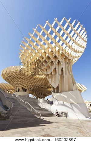 Seville, Spain - May 1, 2016: Metropol Parasol on Plaza de la Encarnacion. The wooden structure designed by architect Juergen Mayer H. is made from bonded timber with a polyurethane coating.