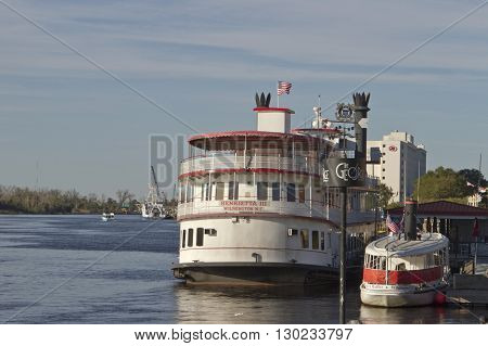 Wilmington, North Carolina, USA - November 13, 2015: A tour boat docks at the Riverwalk Boardwalk on the scenic Cape Fear River in Wilmington, North Carolina