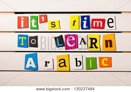 It's time to learn Arabic - written with color magazine letter clippings on wooden board. Learn arabic Concept.
