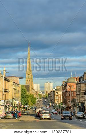 GLASGOW SCOTLAND - MAY 16 2016: View of Great Western Road in Glasgow looking east as the sun is setting.
