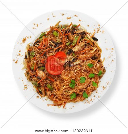 Asian food. Fried Thai glass Rice noodles with mushrooms and vegetables. Vegetarian Chinese transparent glass rice vermicelli fried with meat. Korean funchoza cellophane noodles, top view isolated