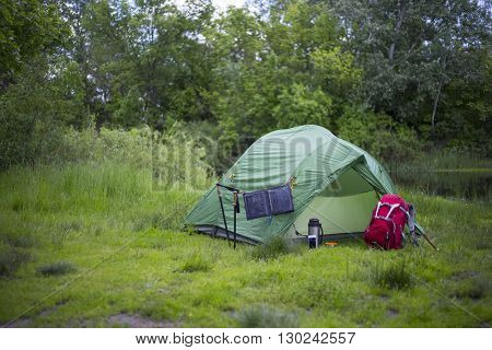 Camping In The Woods On The Banks Of The River.