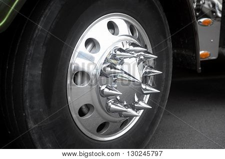 Wheel with chrome tips of a big American truck exhibits at a gathering of American motorcycles in Beaucaire in the French department of Gard