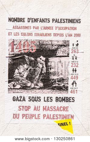 MARSEILLE FRANCE - JUL 18 2014: Gaza under bombs - placard about situation in Palestina seen on a wall in French city of Marseille