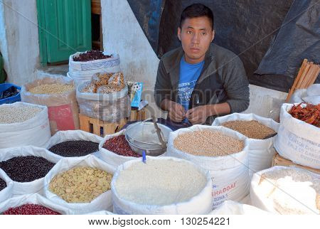 CHICHICASTENANGO GUSTEMALA APRIL 29 2016: Portrait of a Mayan young man have beans for sale. The Mayan people still make up a majority of the population in Guatemala,