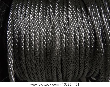 Galvanized steel wire rope in bobbin texture background poster