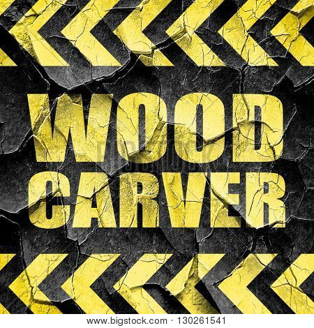 wood carver, black and yellow rough hazard stripes